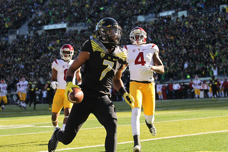 Nov 21, 2015; Eugene, OR, USA; Oregon Ducks wide receiver Darren Carrington (7) reacts after making a touchdown against the USC Trojans at Autzen Stadium. <br /> Photo by Jaime Valdez