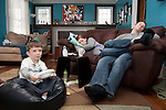 After putting the triplets down for a nap, Sarah and Matthew find time to rest. Benjamin uses this quiet time to play his Wii without any distractions.