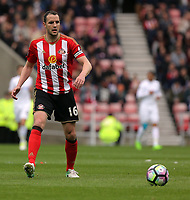 John O'Shea of Sunderland in action during the Premier League match between Sunderland and Swansea City at the Stadium of Light, Sunderland, England, UK. Saturday 13 May 2017