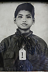 A mug shot of a boy prisoner with a heavy chain around his neck is on display at the Tuol Sleng prison in Phnom Penh, Cambodia. An estimated 17,000 people passed through the prison under the Khmer Rouge from 1975 to 1979. Often entire families were arrested together, and children, along with their parents, were brutally interrogated, made to confess to a list of crimes against the regime, then murdered in the infamous Killing Fields. Only a handful of those who were imprisoned at Tuol Sleng survived.  March 1, 2012.