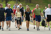 United States President George Bush, second from right, walks with U.S. Secretary of Health and Human Services Mike Leavitt, right, and fitness expert Denise Austin, third from right, and other members of the President's Council on Physical Fitness and Sports as they prepare to take a bicycle ride at the Secret Service Training Facility in Beltsville, Maryland, Saturday, May 5, 2007.  May is National Physical Fitness and Sports Month, and this year marks the 5th Anniversary of the HealthierUS program in the United States.<br /> Credit: Chris Greenberg / Pool via CNP