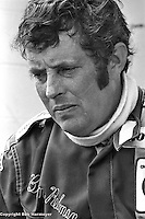 Candid portrait of Brian Redman, driver of the 1977 Lola Chevrolet Can-Am car, at Le Circuit Mont Tremblant/St. Jovite, Quebec, Canada.