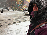 Emily Steinwehe looks up 46th Street in Manhattan during the New York blizzard on 1/4/18