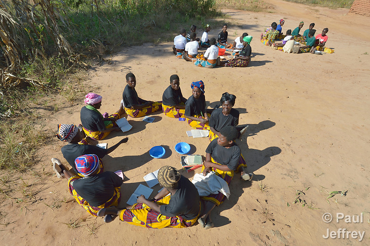 Women's savings groups meet in Kaluhoro, Malawi. With support from the Building Sustainable Livelihoods project of the Ekwendeni Hospital AIDS Program, participants are working together to earn and save money, raise more nutritious food, and receive vocational training.