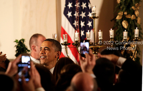 United States President Barack  Obama greets White House guests at the end  of the Hanukkah Reception in the Grand Foyer of the White House  in Washington DC, on December 13, 2012..Credit: Aude Guerrucci / Pool via CNP