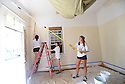 Tulane student Delaney Connor and others paint a living room while volunteering with South Seventh Ward Neighbors, 2016.