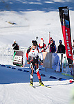 Canadian biathlon athlete Nathan Smith skies over the finish line at The International Biathlon Union Cup # 7 Men's 10 KM Sprint held at the Canmore Nordic Center in Canmore Alberta, Canada, on Feb 16, 2012.  Nathan goes on to win this race, his third win of three sprints held in Canmore.  Two sprints were held the previous weekend in Cup 6.  Photo by Gus Curtis.