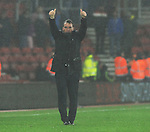 Liverpool Manager Brendan Rodgers thanks the fans at the end of the game in the bad weather - Barclays Premier League - Southampton vs Liverpool - St Mary's Stadium - Southampton - England - 22nd February 2015 - Pic Robin Parker/Sportimage