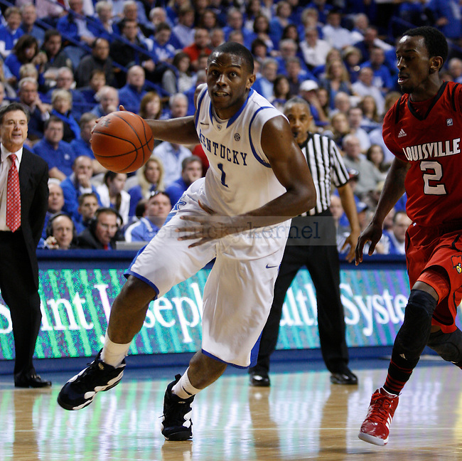 UK's Darius Miller drives to the basket against UofL at Rupp Arena on Saturday, Dec. 31, 2011. Photo by Scott Hannigan | Staff