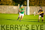Kilmoyleys Adrian Royle about to his the sliotor as Brendan McMahon of Dr Crokes bares down on him, in the Intermediate Hurling Championship semi final.