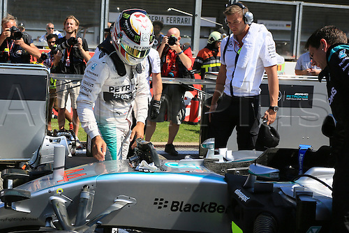 23.08.2015. Spa Francorchamps, Belgium. Formula One World Championship Grand Prix. Race day.  Mercedes AMG Petronas driver Lewis Hamilton gets settled in his car on the grid before the race
