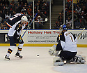 Dec 23, 2008; Uniondale, NY, USA; Atlanta Thrashers goaltender Johan Hedberg (1) stops puck while defenseman Nathan Oystrick (7) and New York Islanders rightwing Trent Hunter (7) block his vision during game at the Nassau Coliseum.Thrashers won 4-2. Mandatory Credit: Tomasso DeRosa/SportPics