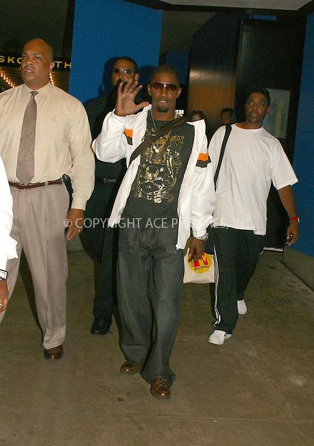 WWW.ACEPIXS.COM . . . . .  ....NEW YORK, JULY 26, 2005....Jamie Foxx arrives for an appearance on MTV's TRL.....Please byline: PAUL CUNNINGHAM - ACE PICTURES..... *** ***..Ace Pictures, Inc:  ..Craig Ashby (212) 243-8787..e-mail: picturedesk@acepixs.com..web: http://www.acepixs.com