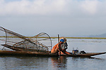 A couple of fishermen in Inle Lake using cone-shaped nets