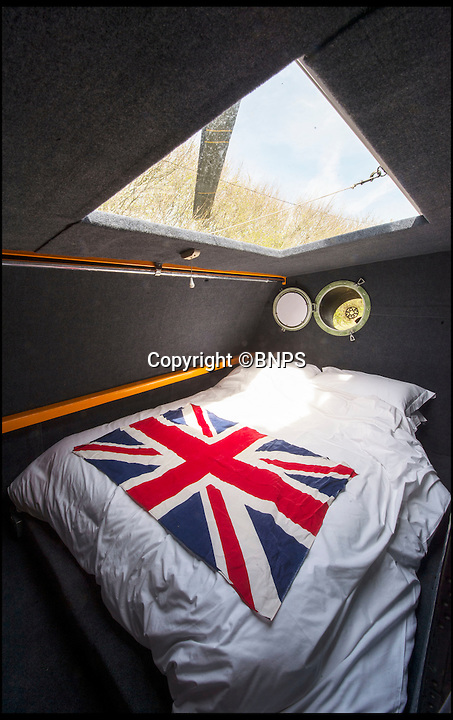 BNPS.co.uk (01202 558833)<br /> Pic: PhilYeomans/BNPS<br /> <br /> Double bed in a side pod...<br /> <br /> Ultimate Heli-pad for a holiday - Campsite owner Stewart Dungey is hoping his new venture takes off - after turning a decommissioned Royal Navy helicopter into a unique holiday let.<br /> <br /> Stewart has spent &pound;30,000 buying, transporting and converting a Cold War Westland Wessex chopper on his farm on the Isle of Wight<br /> <br /> With an Airstream caravan kitchen annex one side and a bedroom pod on the other the chopper now provides luxury accomodation for adventurous families.