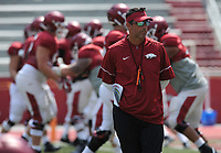 NWA Democrat-Gazette/ANDY SHUPE<br /> Arkansas offensive coordinator Dan Enos watches Saturday, Aug. 5, 2017, prior to the start of a scrimmage in Razorback Stadium in Fayetteville. Visit nwadg.com/photos to see more photographs from the practice.