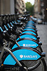 Row of Barclay's bicycles in London. background blurred.