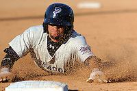 Pensacola Blue Wahoos shortstop Billy Hamilton #4 steals third during  game one of a double header against the  Tennessee Smokies at Smokies Park on July 30, 2012 in Kodak, Tennessee. The Smokies defeated the Blue Wahoos 6-3 in game one and 3-2 in game two. (Tony Farlow/Four Seam Images).