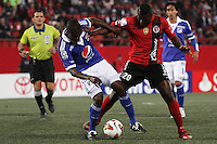 TIJUANA -MÉXICO, 10-04-2013. Duvier Riascos (D) del Tijuana y Jeison Moreno (I)  de Millonarios disputan el balón durante el juego de la fase de grupos de la Copa Libertadores 2013 en el Estadio Caliente en Tijuana, Mexico./  Duvier Riascos  (r) of Tijuana and Jeison Moreno (l) of Millonarios fights for tha ball during match of the groups stage of Libertadores Cup 2013 at Caliente stadium in Tijuana, Mexico.  Photo: Fausto Vargas /JAM MEDIA/VizzorImage