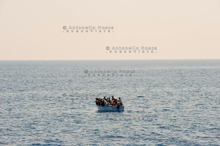 Una barca con a bordo clandestini provenienti dall'Africa e intercettata al largo dell'isola di Lampedusa..Immigrants from Africa during their cross to reach Italy.