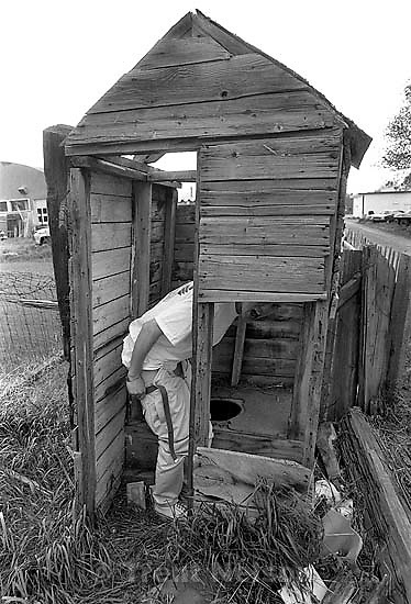 Bergen Wilde pulls down his pants in old outhouse<br />