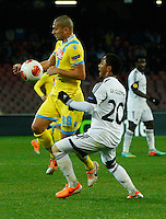 Gokhan Inler  Jonathan De Guzman fight for the ball<br /> <br />  UEFA Europa League round of 32 second  leg match, betweenAC  Napoli  and Swansea City   at San Paolo stadium in Naples, Feburary 27 , 2014