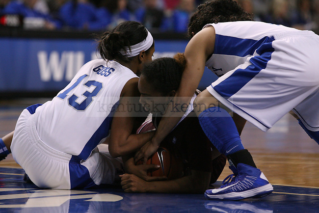 UK sophomore guard Bria Goss and sophomore point guard Jennifer O'Neill wrestle a Mississippi State player for the ball at Memorial Coliseum on Thursday, January 17, 2013 in Lexington, Ky.  Photo by Adam Pennavaria | Staff
