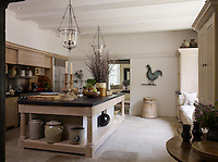 The soapstone-topped kitchen island was designed to look like a medieval banqueting table