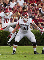 Hawgs Illustrated/BEN GOFF <br /> Hjalte Froholdt (51), Arkansas offensive lineman, blocks as Blake Johnson punts to South Carolina Saturday, Oct. 7, 2017, at Williams-Brice Stadium in Columbia, S.C.