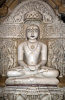 A hand carved WHITE MARBLE statue of MAHAVIRA in the  CHANDRAPRABHU JAIN TEMPLE inside JAISALMER FORT - RAJASTHAN, INDIA.