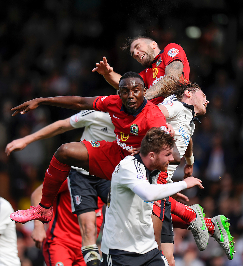 Blackburn Rovers' Shane Duffy (top) and Bengadli-Fode Koita battles for possession with Fulham's Richard Stearman (right) and Ryan Tunnicliffe<br /> <br /> Photographer Ashley Western/CameraSport<br /> <br /> Football - The Football League Sky Bet Championship - Fulham v Blackburn Rovers - Sunday 13th September 2015 - Craven Cottage<br /> <br /> &copy; CameraSport - 43 Linden Ave. Countesthorpe. Leicester. England. LE8 5PG - Tel: +44 (0) 116 277 4147 - admin@camerasport.com - www.camerasport.com