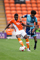Sido Jombati of Wycombe Wanderers looks to regain possession from Bright Osayi-Samuel of Blackpool during the Sky Bet League 2 match between Blackpool and Wycombe Wanderers at Bloomfield Road, Blackpool, England on 20 August 2016. Photo by James Williamson / PRiME Media Images.
