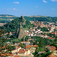 France, Auvergne (Massif Central), Departement Haute-Loire, Le Puy-en-Velay: view of town with Cathedral of Le Puy, UNESCO World Heritage Site and iron statue of Notre-Dame de France (The Virgin Mary) atop the volcanic cone Rocher Corneille, at foreground chapel Saint Michel d'Aiguilhe | Frankreich, Auvergne (Massif Central), Departement Haute-Loire, Le Puy-en-Velay: die groesste Stadt im Departement Haute-Loire und ein Ausgangspunkt zum Jakobsweg nach Santiago de Compostela mit der Kathedrale von Le Puy-en-Velay, die zum Weltkulturerbe der UNESCO gehoert und der Marienstatue auf dem Vulkankegel Rocher Corneille; im Vordergrund die Kapelle Saint Michel