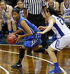 SIOUX FALLS MARCH 23:  Trevena Bennett #22 of Bentley looks around Lubbock Christian defender Kelsey Hoppel #23 during their 2016 NCAA Women's DII Elite 8 Basketball Championship semifinal game Wednesday night at the Sanford Pentagon in Sioux Falls, S.D. (Photo by Dick Carlson/Inertia)