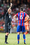 Referee Bobby Madley shows Crystal Palace defender Scott Dann a yellow card during the Premier League Asia Trophy match between Liverpool FC and Crystal Palace FC at Hong Kong Stadium on 19 July 2017, in Hong Kong, China. Photo by Yu Chun Christopher Wong / Power Sport Images