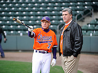 Head coach Jack Leggett (7) of the Clemson Tigers, left, talks with Clemson athletics director Dan Radakovich prior to a game against the South Carolina Gamecocks on Saturday, March 2, 2013, at Fluor Field at the West End in Greenville, South Carolina. Clemson won the Reedy River Rivalry game 6-3. (Tom Priddy/Four Seam Images)
