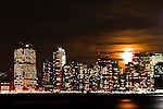 A full moon rises over the skyline lower Manhattan in New York, 9/01/12. New York City, with a population of over 8.1 million, is the most populous city in the United States. It is known for its status as a financial, cultural, transportation, and manufacturing center, and for its history as a gateway for immigration to the United States.   Photo by Eduardo Munoz Alvarez / VIEWpress.