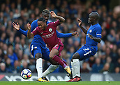 30th September 2017, Stamford Bridge, London, England; EPL Premier League football, Chelsea versus Manchester City; Ngolo Kante of Chelsea and Tiemoue Bakayoko of Chelsea foul Raheem Sterling of Manchester City