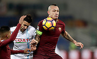 Calcio, Serie A: Roma vs ChievoVerona. Roma, stadio Olimpico, 22 settembre 2016.<br /> Chievo Verona's Ivan Radovanovic, center, fights for the ball against Roma&rsquo;s Emerson Palmieri, left, and Radja Nainggolan, during the Italian Serie A football match between Roma and Chievo Verona, at Rome's Olympic stadium, 22 December 2016.<br /> UPDATE IMAGES PRESS/Isabella Bonotto