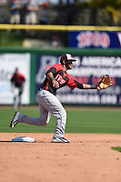 Tampa Spartans shortstop Giovanny Alfonzo (2) stretches for a throw during an exhibition game against the Philadelphia Phillies on March 1, 2015 at Bright House Field in Clearwater, Florida.  Tampa defeated Philadelphia 6-2.  (Mike Janes/Four Seam Images)
