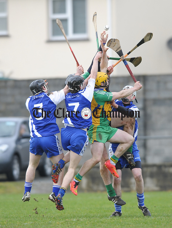 Kilmaley and Inagh-Kilnamona players contest a high ball during their U-21A first round game in Meelick. Photograph by John Kelly.