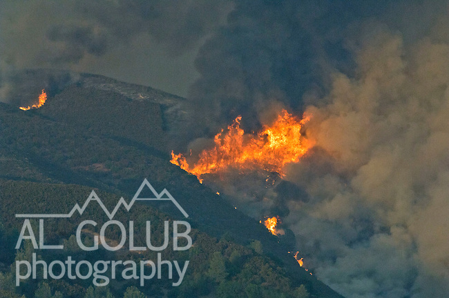 Bear Valley, California-July 25, 2008- Telegraph Fire.Telegraph fire started 3:15 PM near Sherlock Road and Telegraph road near Midpines Area not far from Yosemite National Park.  The photograph was taken at 7:30 PM from Highway 49 looking east to Telegraph Hill On the first day of the fire...by Al GOLUB/Golub Photography