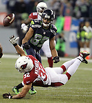 Arizona Cardinals safety Tyrann Mathieu (32) breaks up a pass intended for Seattle Seahawks wide receiver Doug Baldwin (89) CenturyLink Field in Seattle, Washington on November 15, 2015. The Cardinals beat the Seahawks 39-32.   ©2015. Jim Bryant photo. All Rights Reserved.