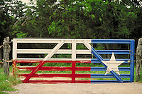 ranch gate painted w  Texas flag. Texas, hill country.