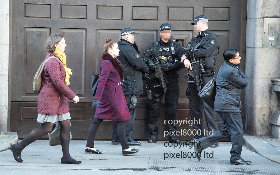 Pic shows: Huge security outside the Old Bailey today for gun smuggling gang on trial. <br /> <br /> But London commuters were unfazed by the dozen or so police armed with automatic weapons.<br /> <br /> <br /> <br /> <br /> Pic by Gavin Rodgers/Pixel 8000 Ltd