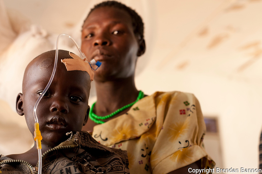 Amoo Grace with her 2 year old child Rackara Emmanuel. Rackara  came to the MSF supported  health facilty in Madi Opei, Uganda for malaria treatment and was released after responding well to treatment.
