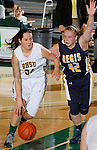 SPEARFISH, SD - DECEMBER 21, 2013:  Callie Bechtel #34 of Black Hills State drives on Jena Blasingame #42 of Regis during their Rocky Mountain Athletic Conference game Saturday at the Donald E. Young Center in Spearfish, S.D.  (Photo by Dick Carlson/Inertia)