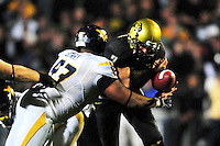 18 September 08: West Virginia defensive lineman Scooter Berry (in white) sacks Colorado quarterback Cody Hawkins who fumbled the football. The Colorado Buffaloes defeated the West Virginia Mountaineers 17-14 in overtime at Folsom Field in Boulder, Colorado. For Editorial Use Only.