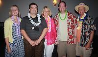 NWA Democrat-Gazette/CARIN SCHOPPMEYER Ali Demorotski (from left), Jeremy Minchew, Jenna Johnston, Elizabeth Richardson Center board president, Drew Demorotski and David Demorotski gather at the fifth annual Beach Bingo Bash.