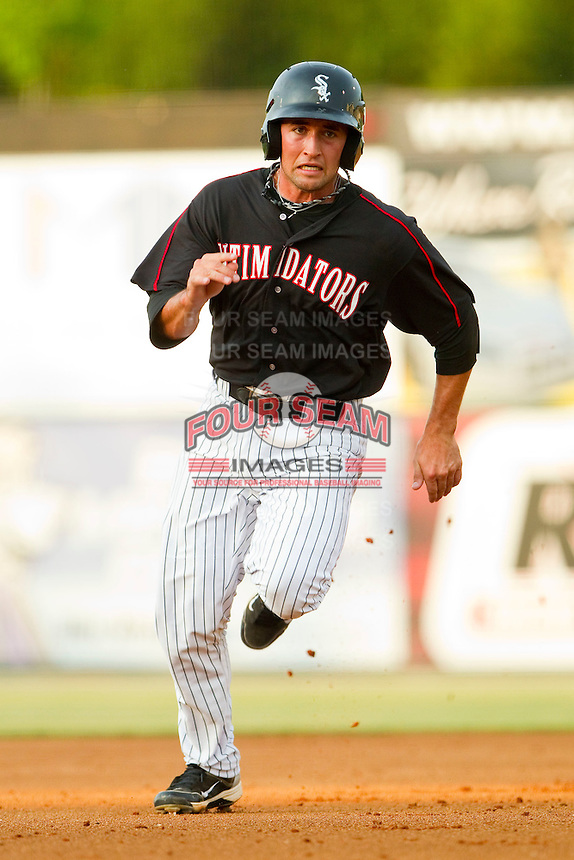 Drew Lee #11 of the Kannapolis Intimidators hustles towards third base against the Delmarva Shorebirds at Fieldcrest Cannon Stadium on May 23, 2011 in Kannapolis, North Carolina.   Photo by Brian Westerholt / Four Seam Images